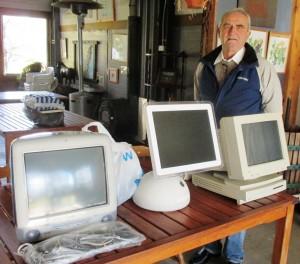 Dr Peter Bilenkij with three generations of Apple computers.