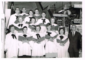 The Western Stores staff choir Christmas 1964.back row-l-r Geoff Cullen, Max Connolly, unknown, David Eyles, Robert Mendham. middle row - Kerry Wood, Carol Deans, Barbara Schmich. front row- Marj Salter, unknown, Ruth Wilkins Sue Britton, Mabel Forrester, Jim Longman